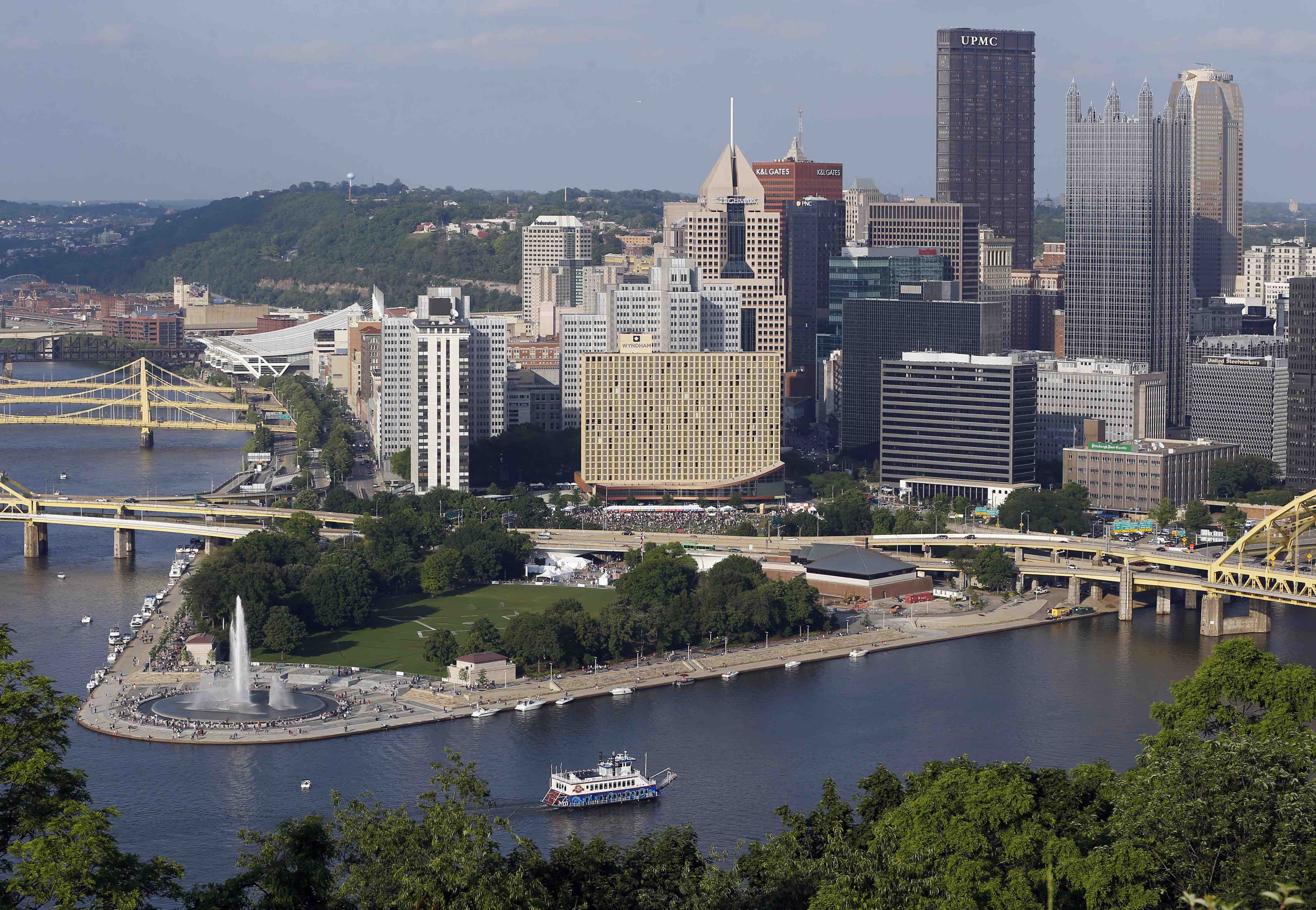 The Pittsburgh skyline raises above the newly renovated fountain at Point State Park, left, on Saturday, June 8, 2013, in Pittsburgh. The iconic fountain at the confluence where the Allegheny and Monongahela Rivers meet to form the Ohio River, was originally opened in 1974. It had been shut off since 2009 and was reopened on Friday, June 7, 2013 after it underwent an $11.9 million restoration. (AP Photo/Keith Srakocic)