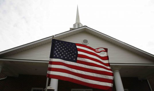 Photo of flag in front of the First Baptist Church of Gallant.