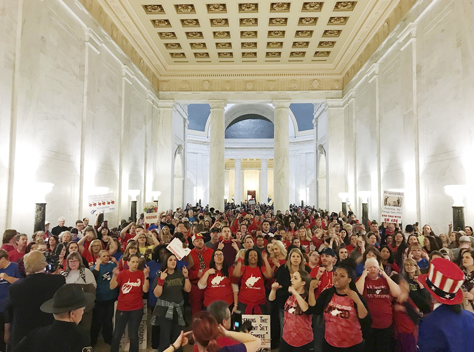 Teachers celebrate after West Virginia Gov. Jim Justice and Senate Republicans announced they reached a tentative deal to end a statewide teachers' strike by giving them 5 percent raises in Charleston, W.Va., Tuesday, March 6, 2018. Photo: Robert Ray/AP
