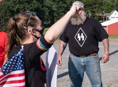 A counter protestor wearing a Nazi SS shirt shouts at Black Lives Matter marchers in Kingwood, West Virginia on September 12, 2020. Photo: Chris Jones/100 Days in Appalachia