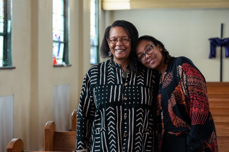 Dr. Norma Thomas and her daughter Dr. Raina León pose for a portrait inside John Wesley AME Zion Church in Uniontown, Pennsylvania. Thomas has spent years collecting documentation of Black history in Fayette County, starting with her own family in nearby Hopwood. Photo: Justin Hayhurst/100 Days in Appalachia