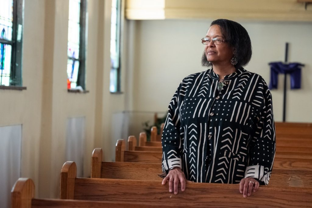 Dr. Norma Thomas inside John Wesley AME Zion Church in Uniontown, Pennsylvania. The church is an important historical landmark as it was once a safe house for slaves traveling north on the Underground Railroad. Photo: Justin Hayhurst/100 Days in Appalachia