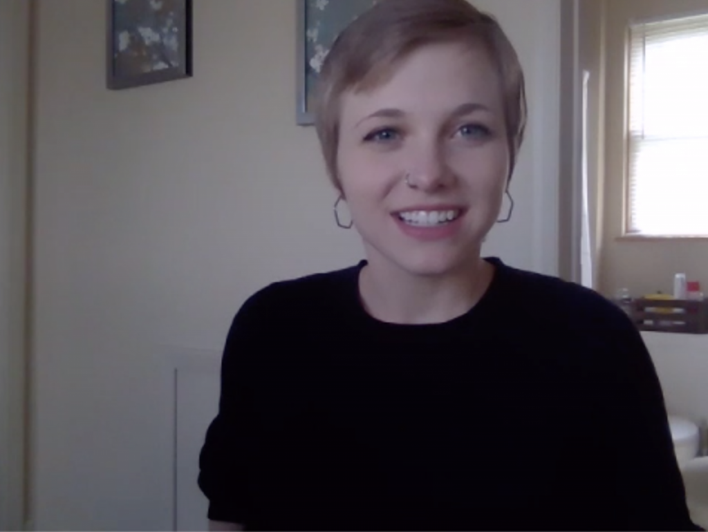 photo of a white woman with short blonde hair smiling in the camera