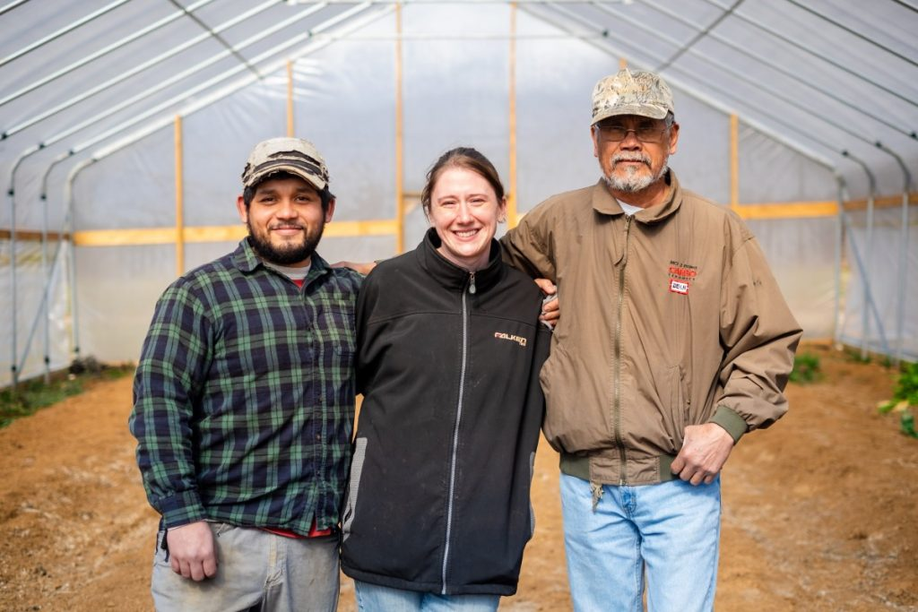 Salvador Moreno Jr., left, Alyssa Moreno, center, and Salvador Moreno Sr., right, own and operate SMM Farm in Western North Carolina. Photo: Aaron Dahlstrom/100 Days in Appalachia