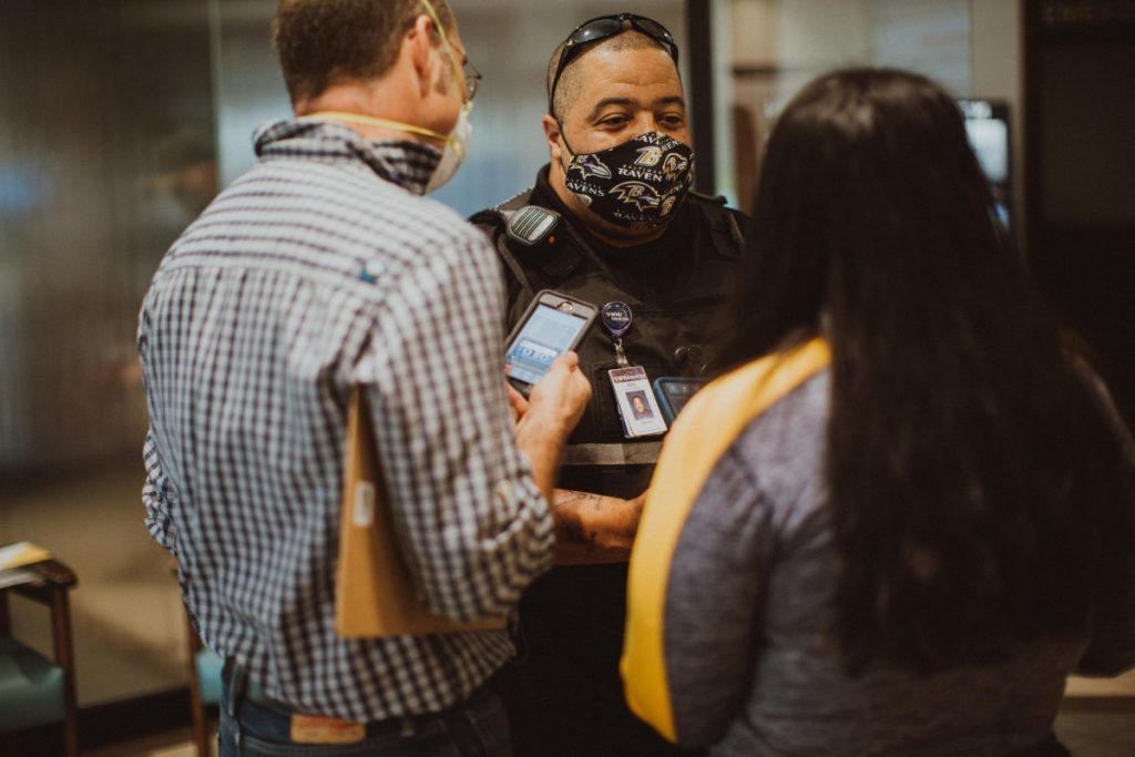 Officer Paul Blackman speaks to the Healthcare is Human podcast producers in the lobby of the Berkeley Medical Center during a time when no visitors were allowed in the hospital. Photo: Molly Humphreys/Healthcare is Human