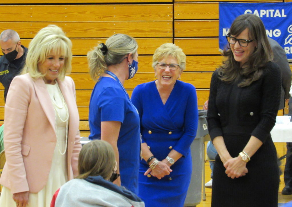 Gayle Manchin, center, shares a laugh with First Lady Jill Biden, left, and actress Jennifer Garner, right, at an event to promote COVID-19 vaccinations in Charleston, West Virginia. Photo: Curtis Tate/OVR