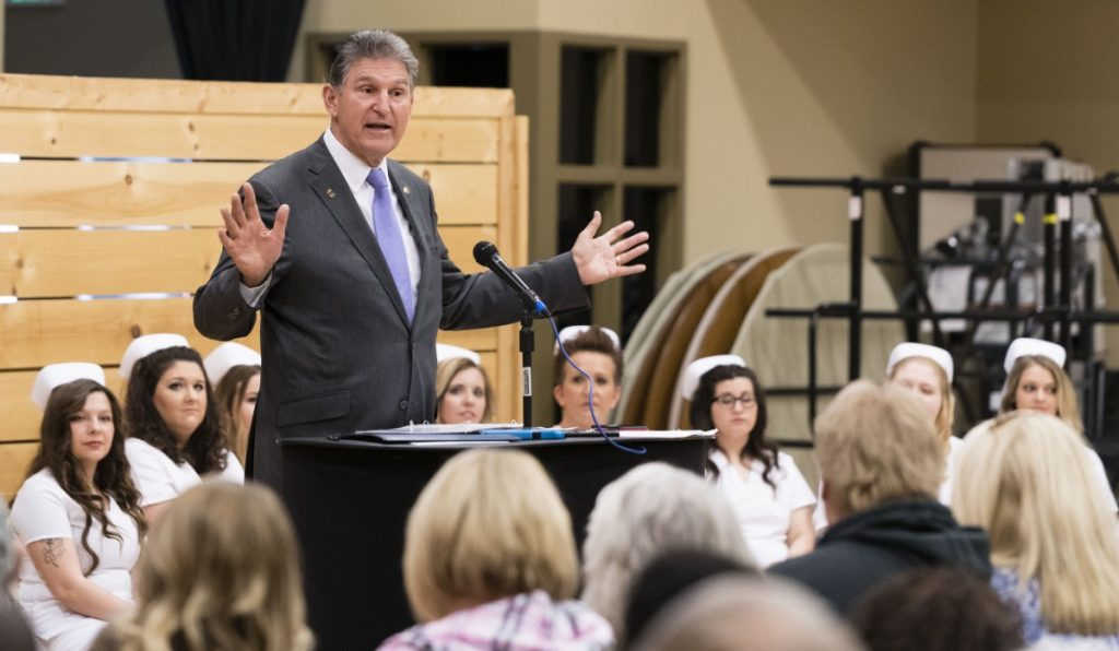 U.S. Sen. Joe Manchin, D-W.Va., speaks at a commencement ceremony for nursing students from West Virginia Junior College on April 20, 2018, at Chestnut Ridge Church, in Morgantown. Photo: Jesse Wright/100 Days in Appalachia