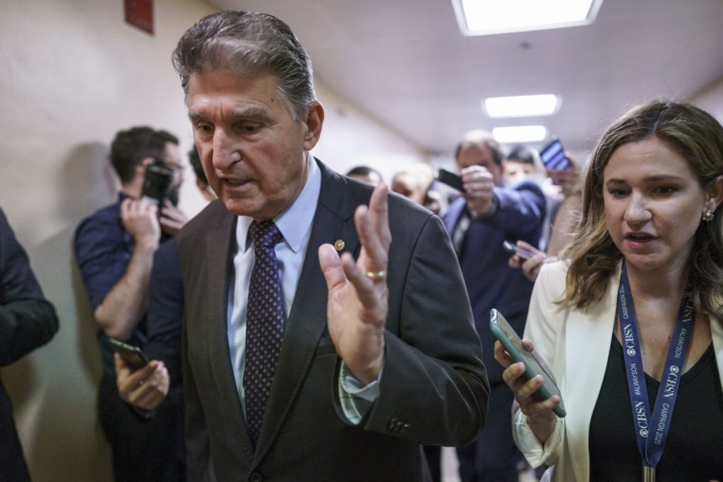 Sen. Joe Manchin, D-W.Va., a crucial 50th vote for Democrats on President Joe Biden's proposals, walks with reporters as senators go to the chamber for votes ahead of the approaching Memorial Day recess, at the Capitol in Washington, Thursday, May 27, 2021. Senate Republicans are ready to deploy the filibuster to block a commission on the Jan. 6 insurrection, shattering chances for a bipartisan probe of the deadly assault on the U.S. Capitol and reviving pressure to do away with the procedural tactic that critics say has lost its purpose. Photo: J. Scott Applewhite/AP Photo