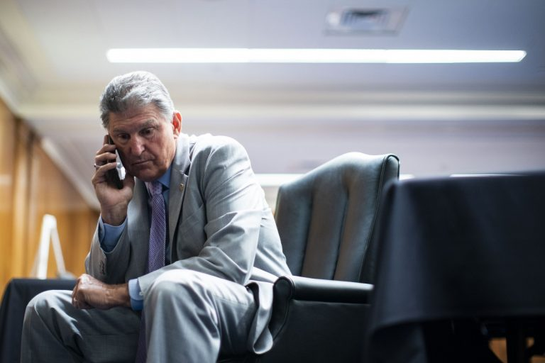 Sen. Joe Manchin, D-W.Va., talks on his phone before Secretary of Health and Human Services Xavier Becerra, speaks during a Senate Appropriations Subcommittee hearing, Wednesday, June 9, 2021, on Capitol Hill in Washington. Photo: Al Drago/Pool via AP
