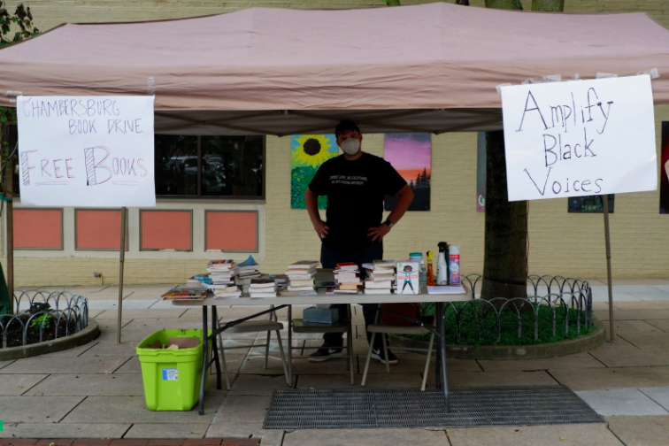 The Chambersburg Holiday Book Drive (co-led by Madison Mellinger, Kelton Chastulik, and Kyle Chastulik) spearheaded an Amplify Black Voices campaign through which they collected books by Black authors and circulated them throughout the Franklin County community at three local BLM demonstrations. In this image, Kelton is setting up the book distribution tent on the Chambersburg Square for the Juneteenth Love Demonstration, covered by the New York Times. Photo: Provided