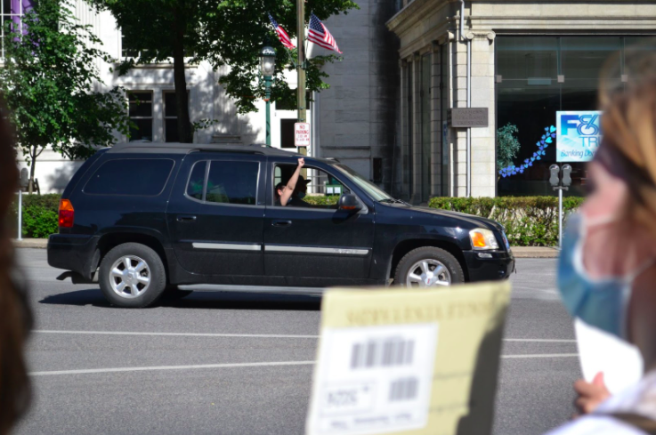 As cars drove past, many, to my disbelief, were very enthusiastic about the protest. Individuals would honk their cars, wave, or raise a fist out of the car window between the traffic light cycles, as pictured. Photo: LeShan Wilkinson