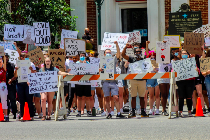 This photograph is depicting one of the many youth-led Black Lives Matter Protests located in the heart of Chambersburg along the town's square. We tried to fill the sidewalks with as many people with signs to stand against this injustice and support black lives. Photo: LeShan Wilkinson