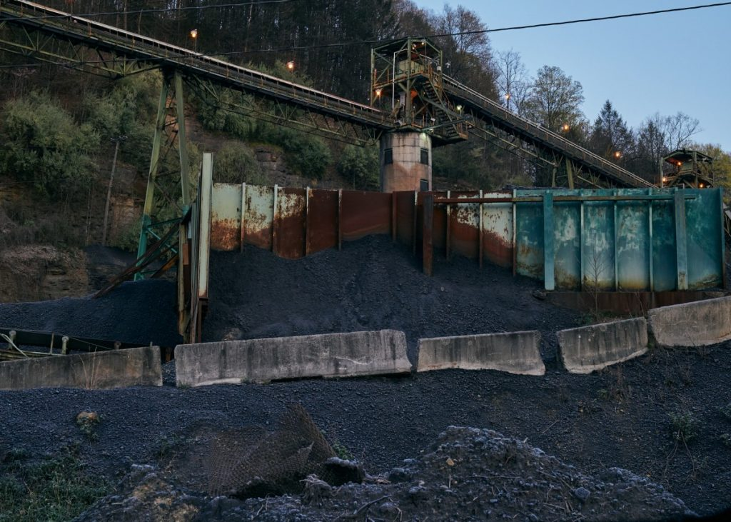 A coal processing and storage facility in Lee County, Virginia. There has been an unprecedented increase in the number of Appalachian miners diagnosed with progressive massive fibrosis in central Appalachian counties, like Lee. This is the most severe form of black lung disease. While coal mining is a declining industry in the region, many cases that are being diagnosed today date back to mining work from the 2000s. Photo: Stacy Kranitz/100 Days in Appalachia