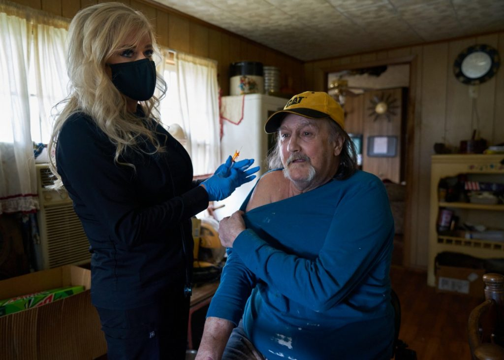 Dr. Teresa Tyson and the Health Wagon team have started to administer COVID-19 vaccines in this part of Appalachia by traveling door-to-door. Here, Tyson prepares to administer a vaccine to Marty Wells at his home in Norton, Virginia. Photo: Stacy Kranitz/100 Days in Appalachia