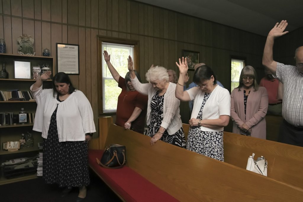 Sunday morning worship at the Sweet Home Old Regular Baptist Church in Coeburn, Virginia. Baptist Churches are declining in numbers, but can still be found along the border of Kentucky and Virginia. Photo: Stacy Kranitz/100 Days in Appalachia