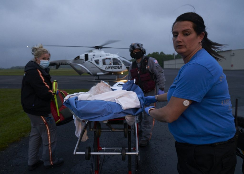 Alison Jeffers and Dallan Phillips work for Scott County Emergency Management Services. The local hospital, Big South Fork Medical Center, is severely underfunded and offers limited emergency services. Clara Terry is taken from the hospital to an air ambulance for a subdural hemorrhage. Photo: Stacey Kranitz/100 Days in Appalachia