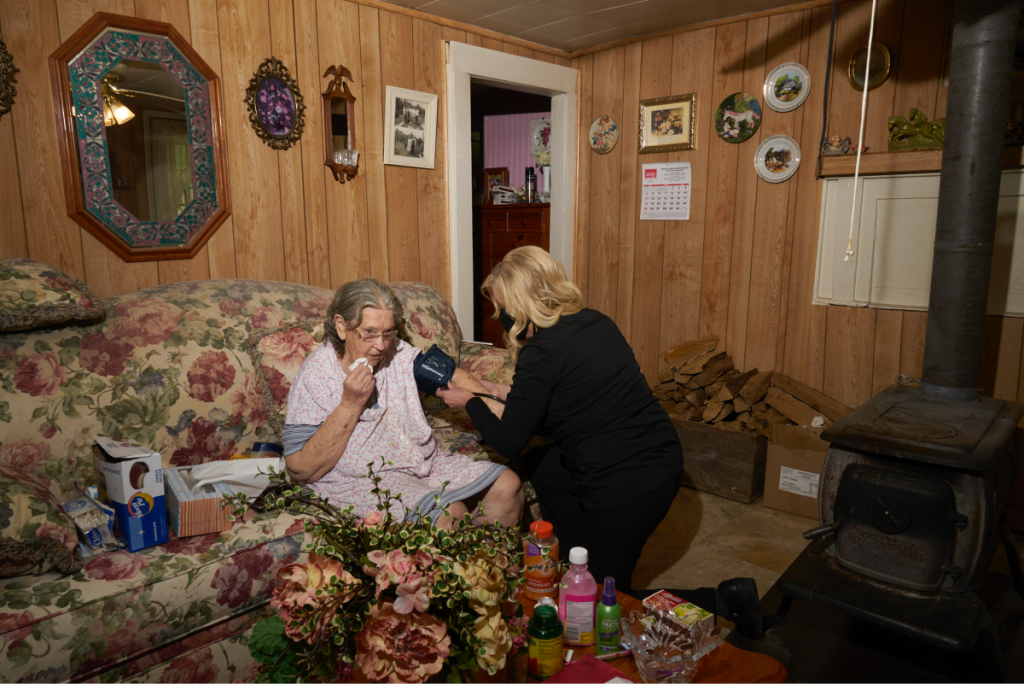 Dr. Teresa Tyson visits Shirley Sparks, 84, at her home in Wise County, Virginia. Shirley, who passed away this summer, lived alone and Tyson liked to stop by and check in on her. Photo: Stacy Kranitz/100 Days in Appalachia