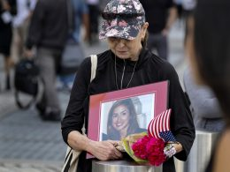 Connie Dray of West Virginia holds a photo Wednesday, Sept. 11, 2019, of her cousin Mary Lou Hague, who died in the World Trade Center attacks of Sept. 11, 2001, as she stands near One World Trade Center while ceremonies marking the 18th anniversary were underway nearby. This was Dray's first time at the ceremonies, saying it was on her list of important things to accomplish, as she also close with Hague's family. Photo: Craig Ruttle/AP Photo