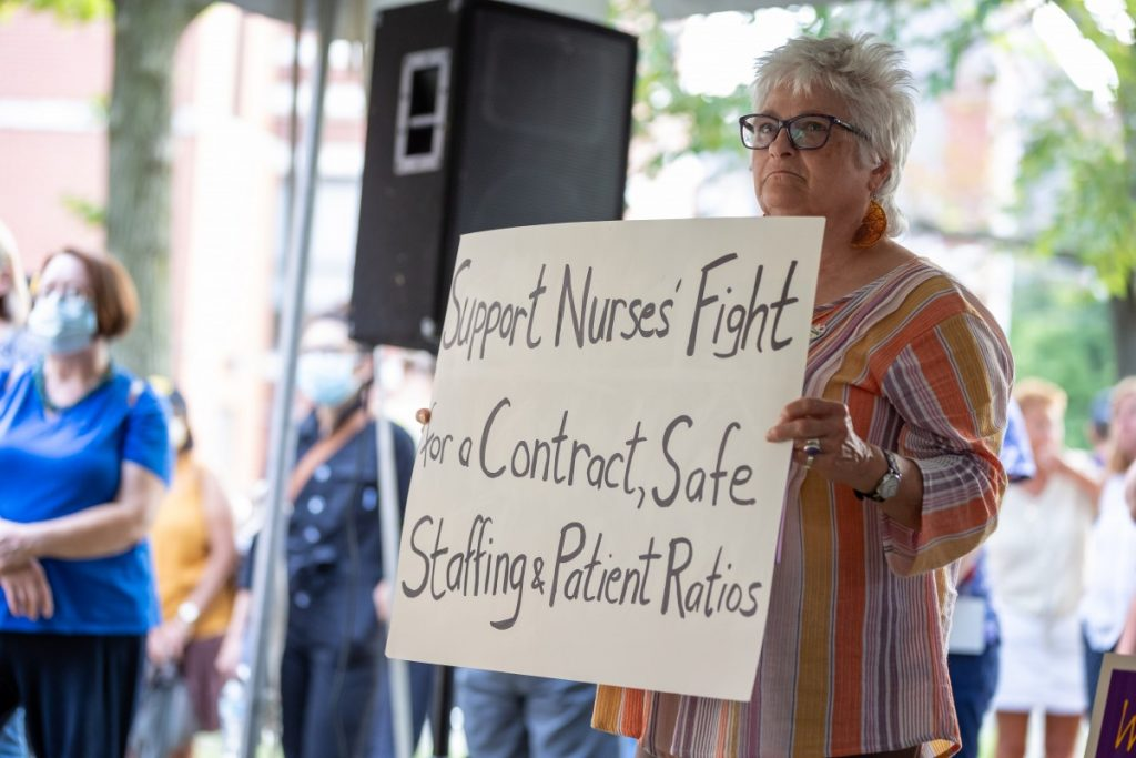 Lorraine Starsky holds a sign during a rally to support unionization efforts outside West Penn hospital on August 3, 2021. Photo: David Smith/100 Days in Appalachia
