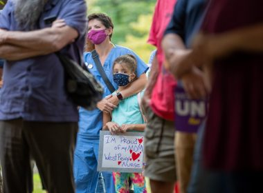 Dani Miller holds a sign during a rally to support unionization efforts outside West Penn hospital on August 3, 2021. Dani's mother Sam, left, is a second-generation healthcare worker at West Penn. Photo: David Smith/100 Days in Appalachia