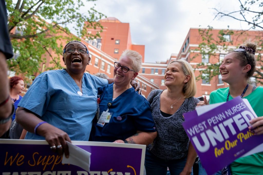 Healthcare workers gather for a group photo during a rally to support unionization efforts outside West Penn hospital on August 3, 2021. Photo: David Smith/100 Days in Appalachia