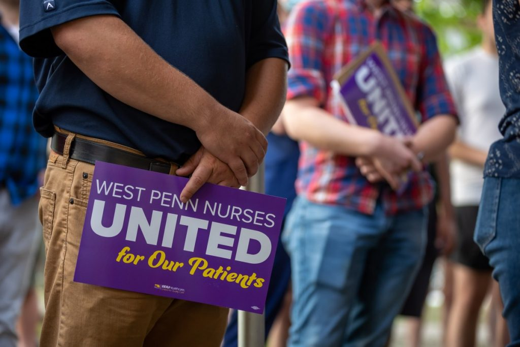 People hold signs in support of West Penn nurses' union organization campaign during a rally outside the hospital on August 3, 2021. Photo: David Smith/100 Days in Appalachia
