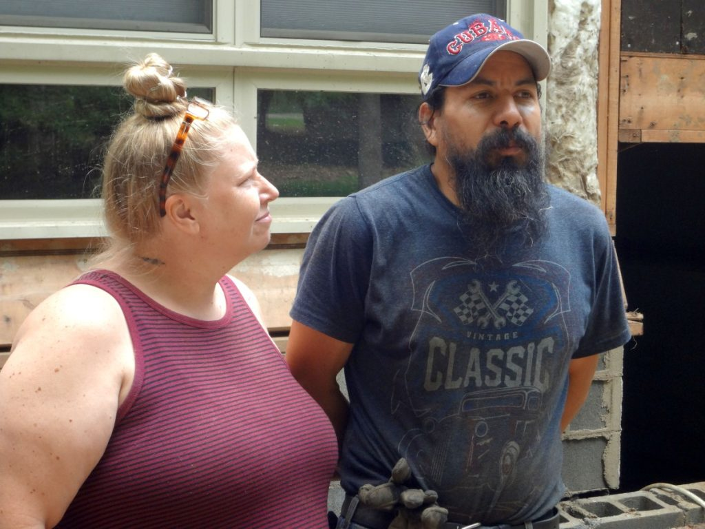"""Crystal and Victor Mancia, relatively new arrivals from Wisconsin, lost their """"home of hospitality"""" in the flooding. Photo: Taylor Sisk/100 Days in Appalachia"""